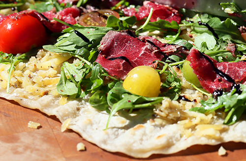 grilled-italian-piadina-topped-with-seard-bison-carpaccio